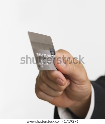 Business man's hand holding a credit card