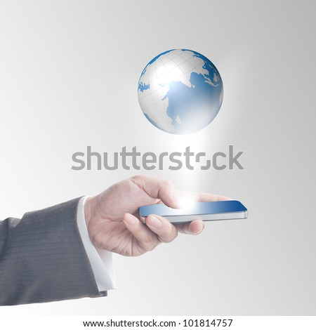 Business man's hand touching on smart phone with glowing digital wire globe