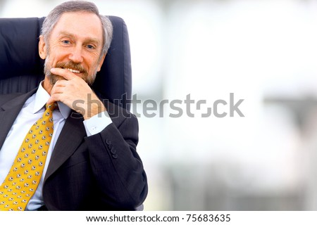 business man seated on a chair