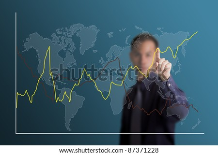 business man selecting to point at fluctuate upward trend graph on world map
