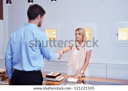 business man selling in jewelry store - stock photo