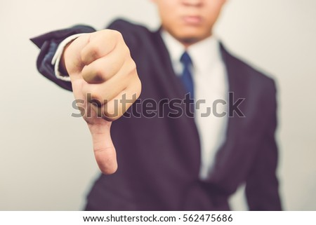 Business man  show thumbs down #562475686