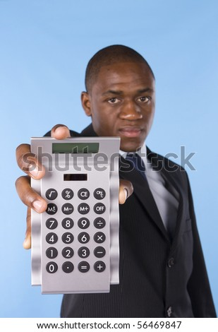 Business man showing a silver calculator