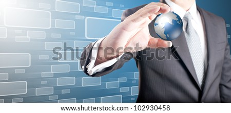 Business man showing digital globe with moving touch screen icons in background
