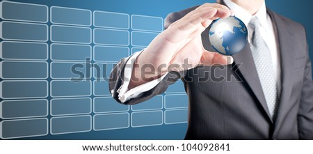 Business man showing digital globe with touch screen icons in background