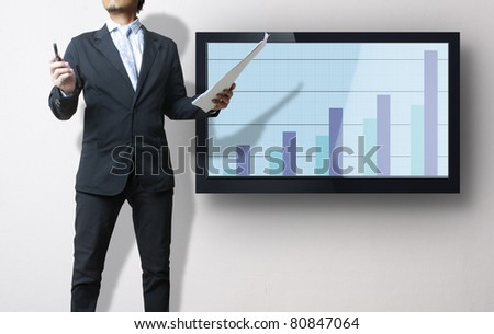 Business man showing financial growth