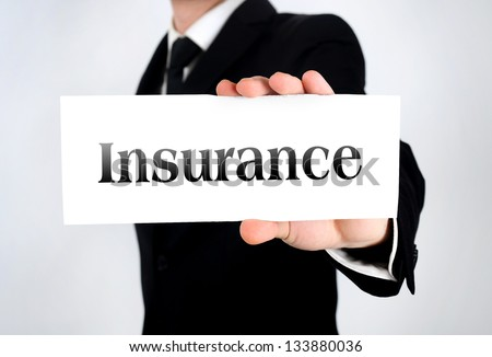 Business man showing insurance word