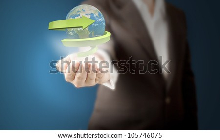 Business man showing realistic globe with green arrow around the world for eco and recycle concept. Elements of this image furnished by NASA.