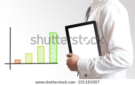 Business man showing tablet PC with graph in background