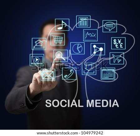 business man showing that social media are the root of many online internet application marget growth