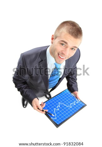 Business man showing the upward trend of a graphic chart.