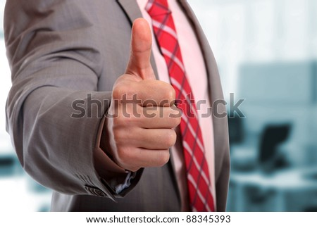 Business man shows thumb up