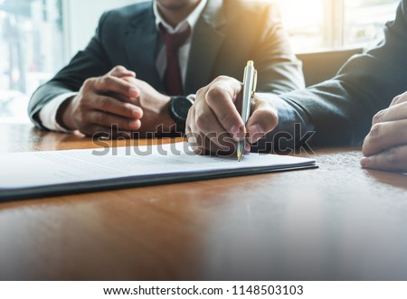 Photo of  Business man sign a contract investment professional document agreement. meeting room.