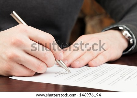 Business man signing documents