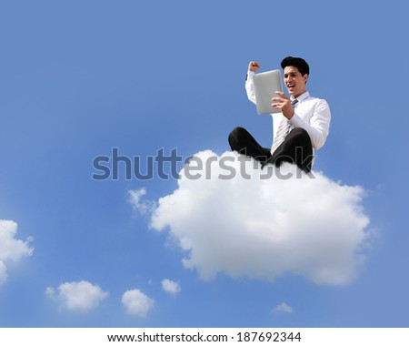 business man sitting on a cloud working with tablet pc computer , cloud computing concept