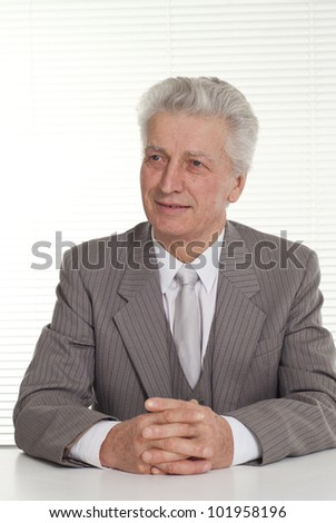 Business man sitting on a white background