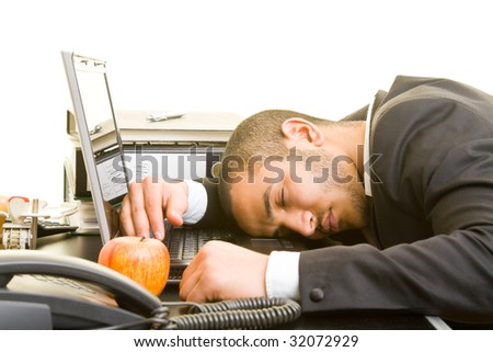 Business man sleeping on his laptop at his desk