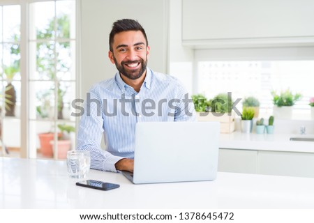 Business man smiling working using computer laptop