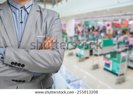 Business Man stand in Hypermarket or Supermarket store present retail marketing