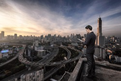 Business man standing over cityscape,Business Technology concept