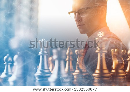 business man strategy brainstorm chess board game with hand touch black background with free copy space for your text