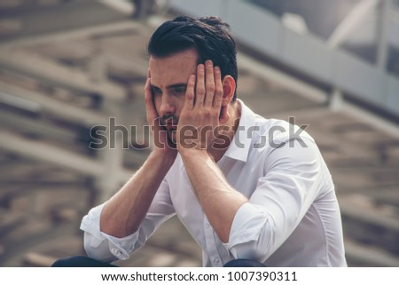 BUSINESS  MAN STRESS TIRED AND SAD UPSET BUSINESS FAILURE CONCEPT #1007390311