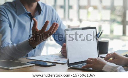 Business man supervising and secretary to execute business plan and consultant analyzing company annual financial report balance sheet statement working with documents graphs. Audit and consultant