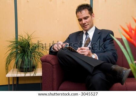business man taking notes in a reception area