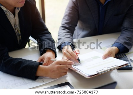 business man talking to consult report paper of financial in office, finance and consulting concept.