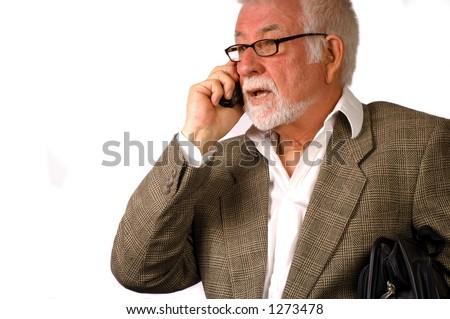 Business man talks on phone