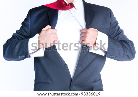 Business man tearing shirt to become a superhero