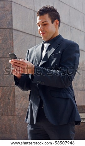 business man texting a message.