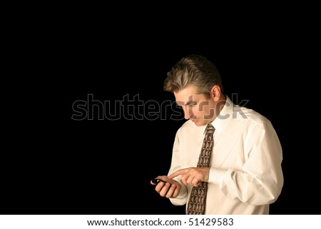 Business man texting on cell phone