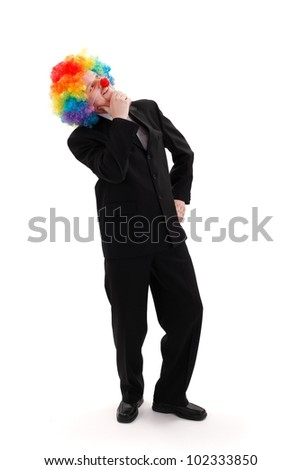 Business man thinking, colorful clown wig on his head