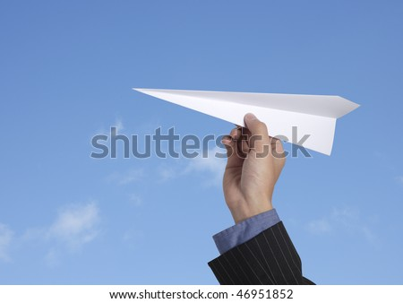 business man throwing a paper plane