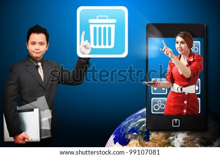 Business man touch the Bin icon from mobile phone : Elements of this image furnished by NASA