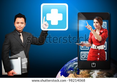 Business man touch the First Aid icon from mobile phone : Elements of this image furnished by NASA - stock photo