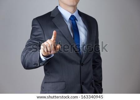 Business man touching an imaginary screen stock photo