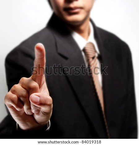 Business man touching an imaginary screen or button