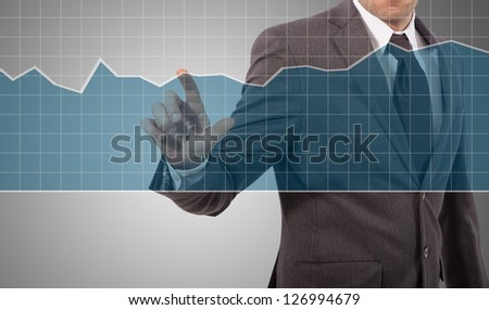 business man touching graph on screen, grey background