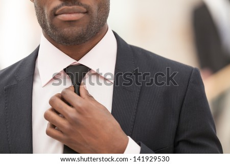 business man touching his tie. Close up