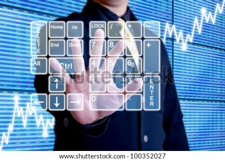 Business man touching on virtual numeric keypad in front of a graph of stock market