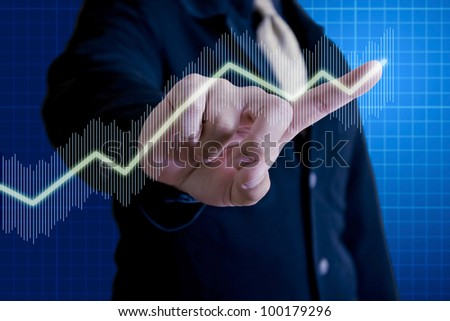 Business man touching on virtual stock graph