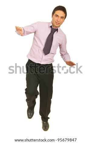 Business man tryind to stand in one leg and holding balance isolated on white background