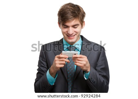Business man use communicator, reading a text message and smiling, handsome young businessman happy smile looking to touch screen cell phone, wear elegant suit and tie isolated over white background
