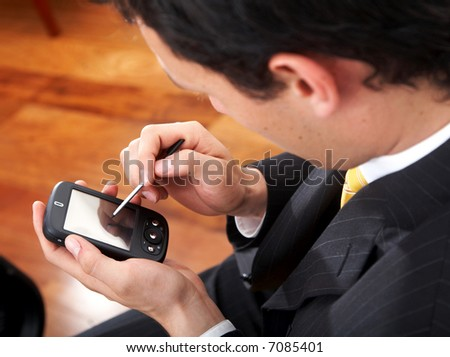 business man using a pda in his office