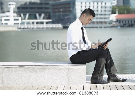Business man using a touch pad