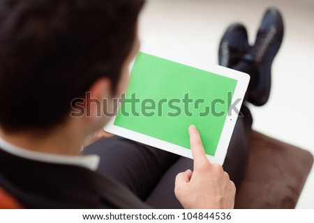 Business man using digital tablet pc with green screen for internet and email