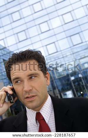 Business man using handy out of office