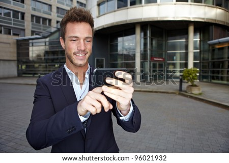 Business man using navigation app in smartphone in urban city
